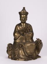 CHINESE BRONZE SEATED MONK ON BUDDHIST LION