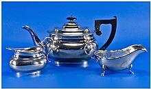 A Silver Matched 3 Piece Tea Service by E. Viner.