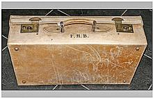 1930's Suitcase with brass lock plates and a pig