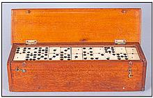 Cased Set Of Bone And Ebony Dominoes. 55 Pieces