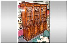 A Reproduction Mahogany Three Door Astral Glazed