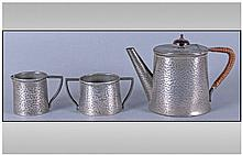 Arts And Crafts Pewter Three Piece Small Tea Set.