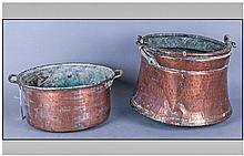 Two Antique Beaten Copper Pots one with swing