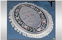 A Chinese oval Shaped Floral Embossed Carpet with