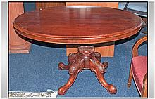A Victorian Mahogany Oval Topped Table. On 4