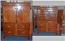A William and Mary Cupboard on A Two Drawer Chest.