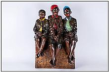 Large Chalk Figure Group Of Three Black Children sitting cross legged on a seat. 22'' in height, 14'' in width.