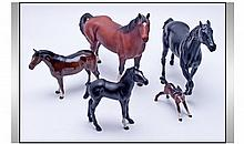 Collection Of Five Beswick Horses. Comprising; 1, brown matte, model number 1182. 2, black matte spirit of fire, model number 2829. Together with anot