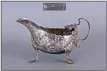 Irish George II Fine Quality Silver Sauce Boat, embossed with trailing foliage and flowers, Hallmark Dublin 1747, Makers Mark J Whitehead. 3.25'' in h