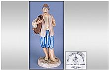 Royal Worcester James Hadley Figure 'The Eastern Watercarrier' modelled by James Hadley. Stands 8'' in height.