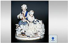 Unter Weiss Bach Lace Group Figure ' A Young Couple ' In 18th Century Costume and Playing a Musical Instrument with a Small Lamb to Feet. Height 6 Inc