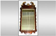 George III Walnut Mirror With Carved & Gilded Applied Decorations Of The Period, with carved tassels down the sides with a shaped & carved decorated t