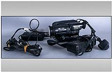 Box Of Cameras & Camera Equipment including Panasonic S-VHS-C Movie Camera, JVC Power Adapter, Panasonic AC Adapter, Battery Pack, Instruction Manuals
