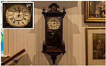 Victorian Walnut Inlaid Cased Wall Clock, makers SKARRAPP, 8 day movement clock. In working order with one finial missing. 44 inches in height.