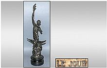 French Late 19th Century Liberty Spelter Figure in the form of a man with eagle below & holding a torch in his outstretched right hand. 20'' in height