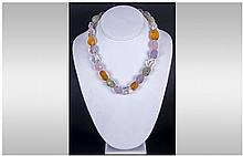 Multi Gemstone Faceted Bead Necklace comprising