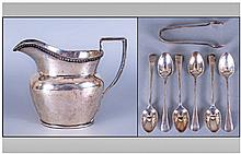 A 19th Century Helmet Shaped Silver Milk Jug Of