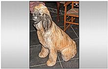A Large Porcelain Figure of an Afghan Hound Dog.