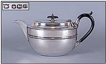 1930's Silver Teapot Of Plain Form with reeded