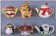 A Good Collection Of Hand Painted Novelty Teapots,