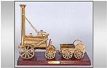 A Brass Model Of Stephensons Rocket, Raised on a