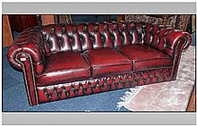 Burgundy leather Three Seater Button Back