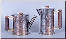 Trench Art Interest. Two silver plated shells,