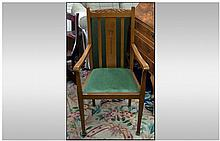 An Oak Edwardian Arm Chair with a carved central