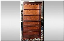 A Tall Mahogany Bookcase with 6 Shelves and shaped