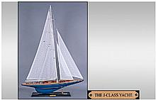Collectors Model Yacht. Raised on black
