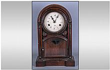 An American Rose Wood Mantle Clock, with a round
