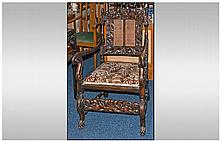 A 1920/1930's Carved Walnut Cane Back Arm Chair,