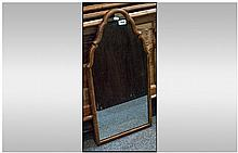 Mirror with Tapering top design. Encased in a wood