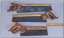 Three Antique Brass Mounted Saws, with wooden