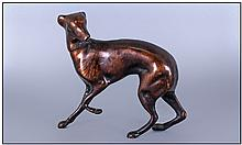 A Bronze Dog Figure Of A Whippet. 5'' in height.