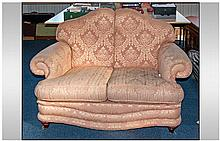A Classic Design 2 Seat Sofa in Pale Pink