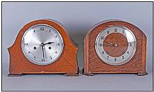 2 Oak Cased Mantel Clocks. With Silver Dials and