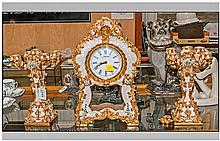 A Gilded Resin 3 Piece clock set in the French