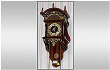 A Dutch Freishland Style Brass Hanging Wall Clock