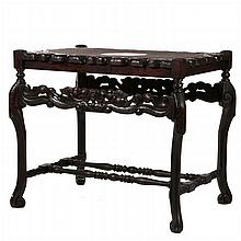 A Spanish Colonial Style Carved Mahogany and Caned Top Table, 19th Century.