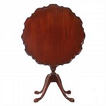 A Chippendale Style Carved Mahogany Tilt Top Table with Piecrust Top By Ferguson, 20th Century.