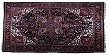 A Heriz Wool Rug, 20th Century.