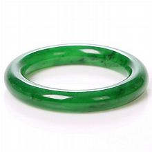 A Chinese Carved Jade Bangle Bracelet, 20th Century.