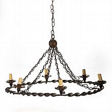 A Wrought Metal Six Light Chandelier, 20th Century.