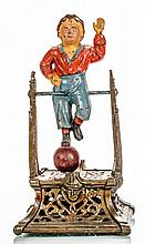 A Cast Iron Boy on Trapeze Mechanical Bank Manufactured by J. Barton Smith Co., ca. 1888,
