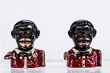 A Pair of Cast Iron Jolly N (Small with Moving Eyes and Round Holes) Mechanical Banks Manufactured in England, ca. 1935-1950,