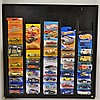 38 Hot wheels in Orig. Boxes Mounted in Frame