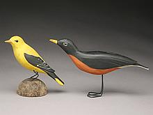 Two bird carvings.