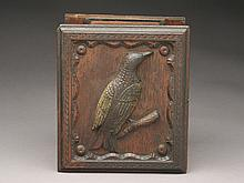 Vintage wooden ammunition box with a carved bird on the cover.