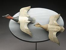 Pair of 1/3 size flying canvasbacks, George Strunk.